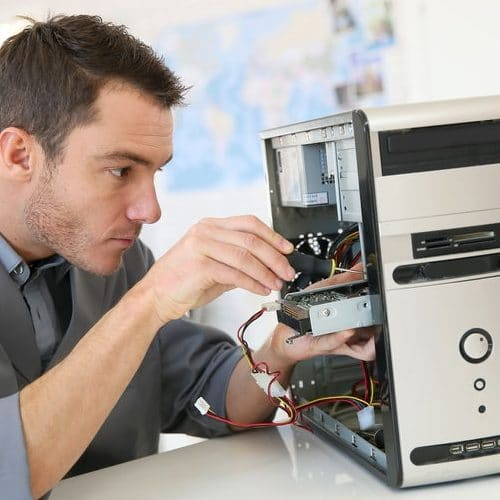 technician-fixing-computer-e1552084698792